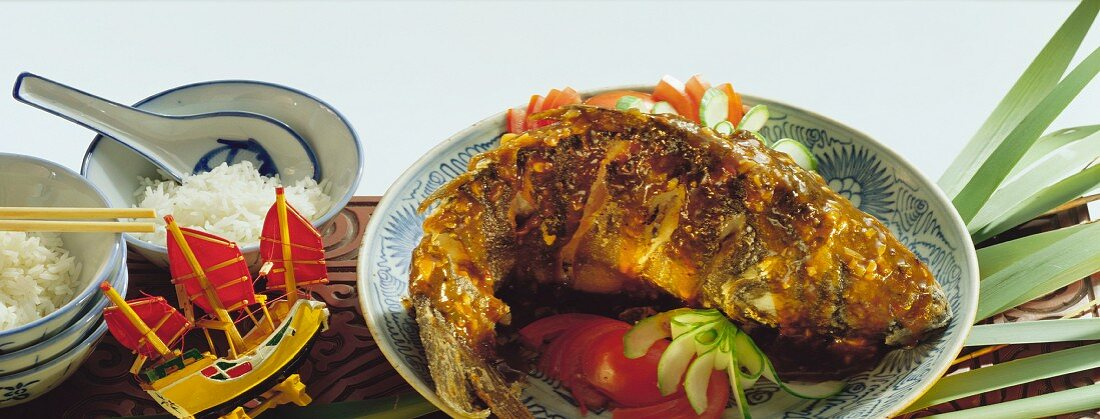 Carp in spicy sauce, garnished with tomatoes & cucumber