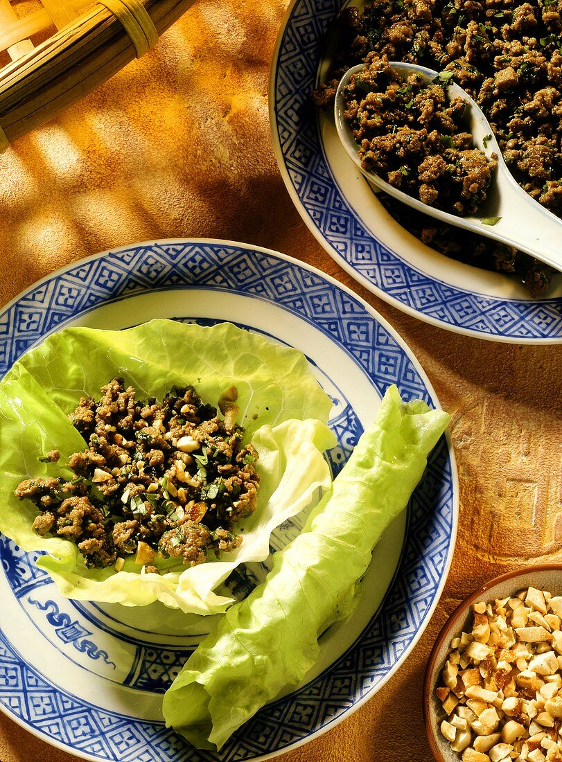 Minced beef with cashew nuts on lettuce leaf