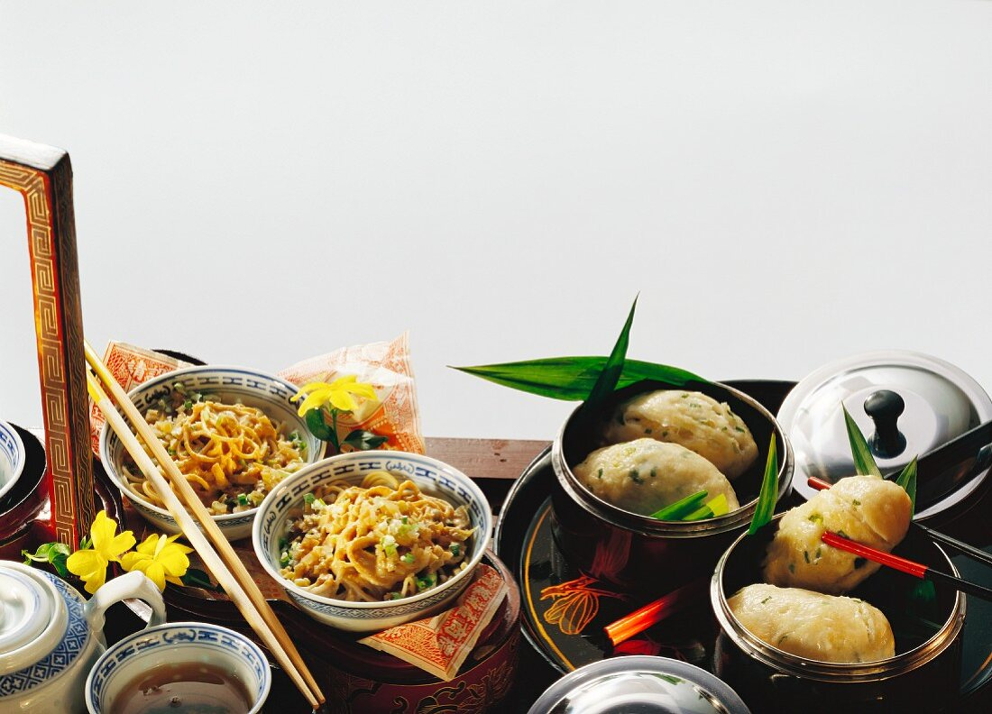 Noodles with vegetables; yeast rolls with spring onions