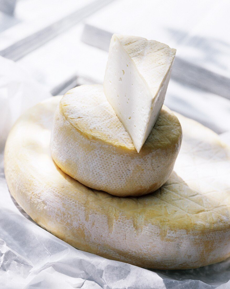 Two Wheels and a Wedge of Soft Cheese; Stacked