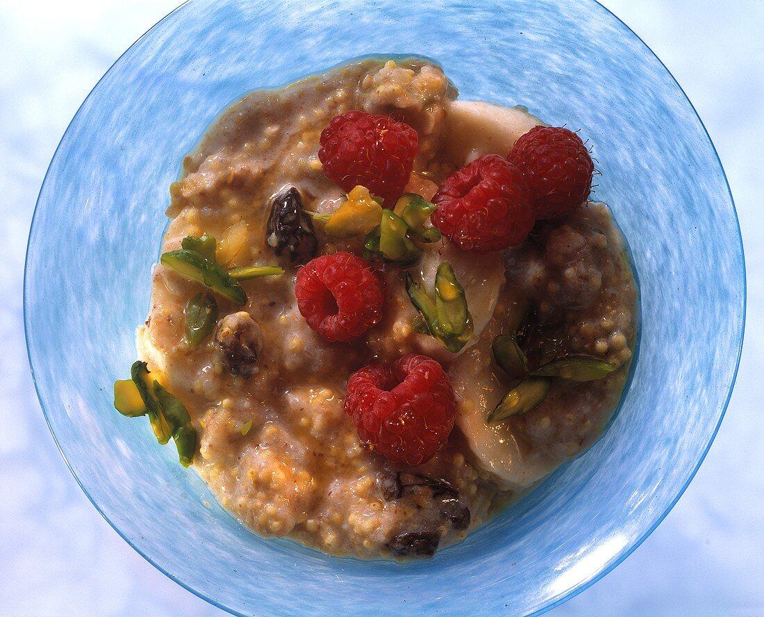 Fresh grain porridge with raspberries, bananas & pistachios