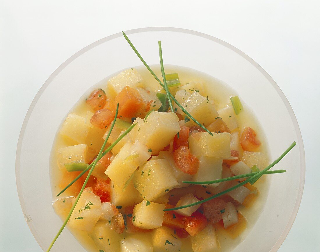 Bouillon potatoes with tomatoes and chives
