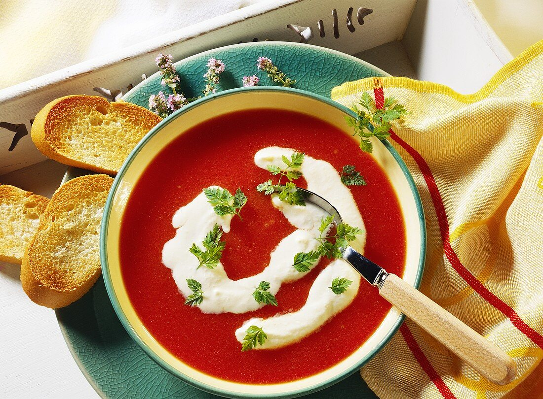Potato & tomato soup with orange cream, chervil & white bread