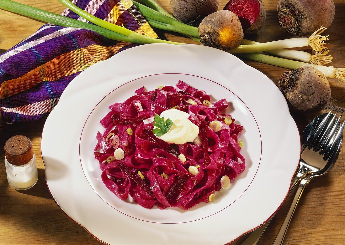 Red ribbon noodles with beetroot & spring onions