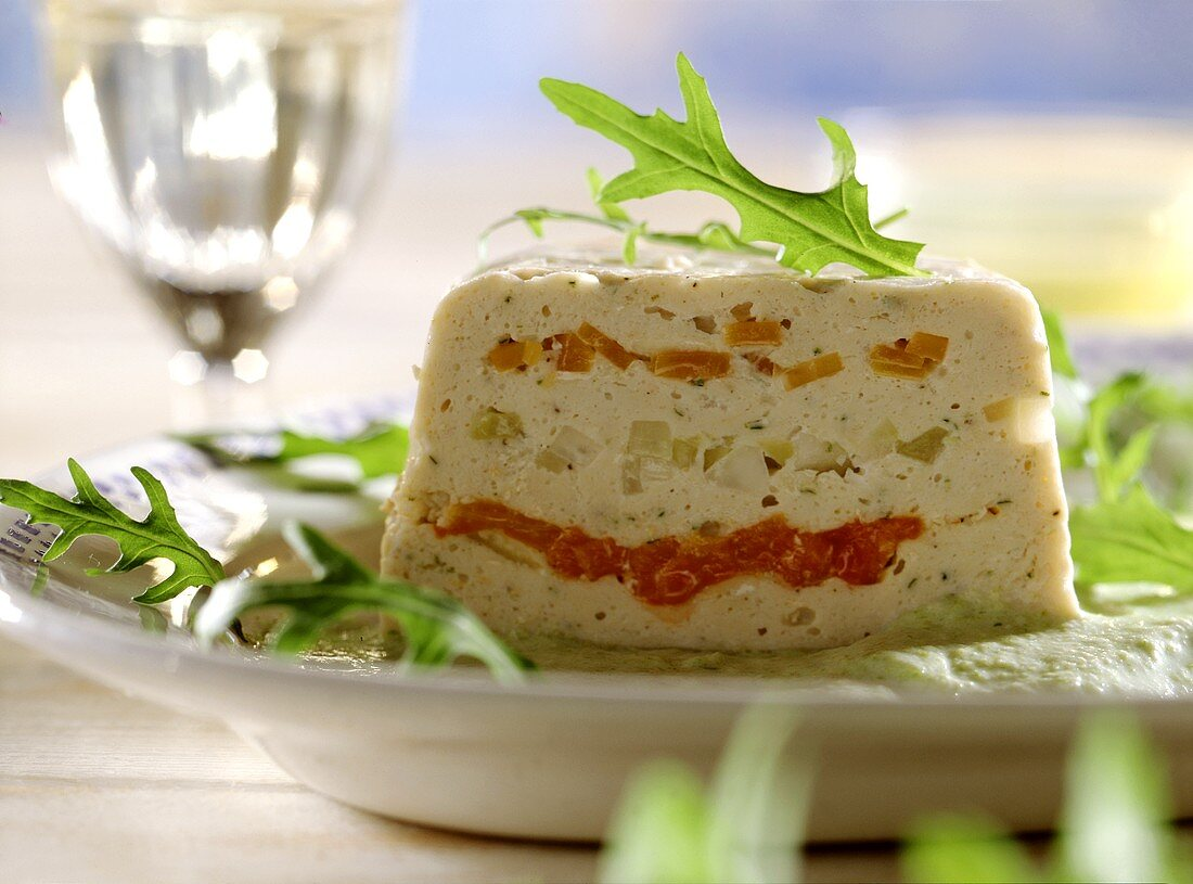 Vegetable terrine with asparagus mousse, with rocket garnish