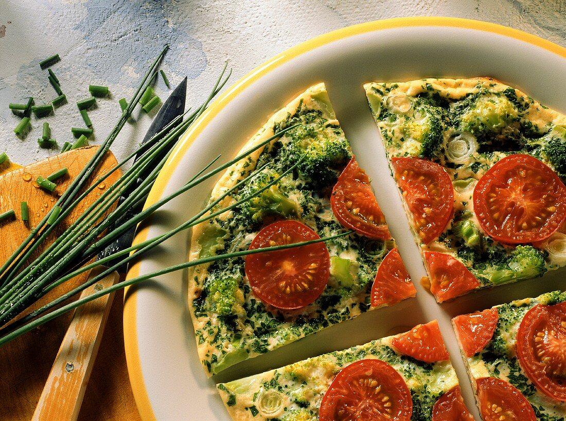 Broccoli tortilla with small tomatoes, cut into quarters