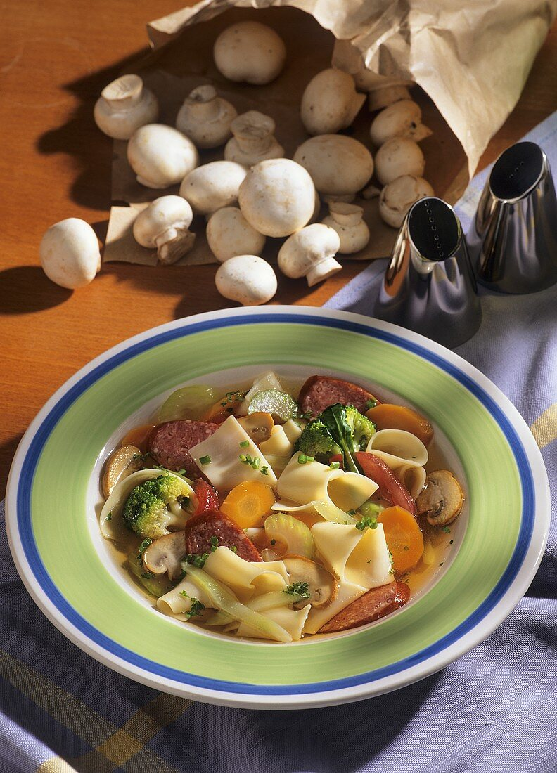 Pasta stew with cabanossi, vegetables and mushrooms