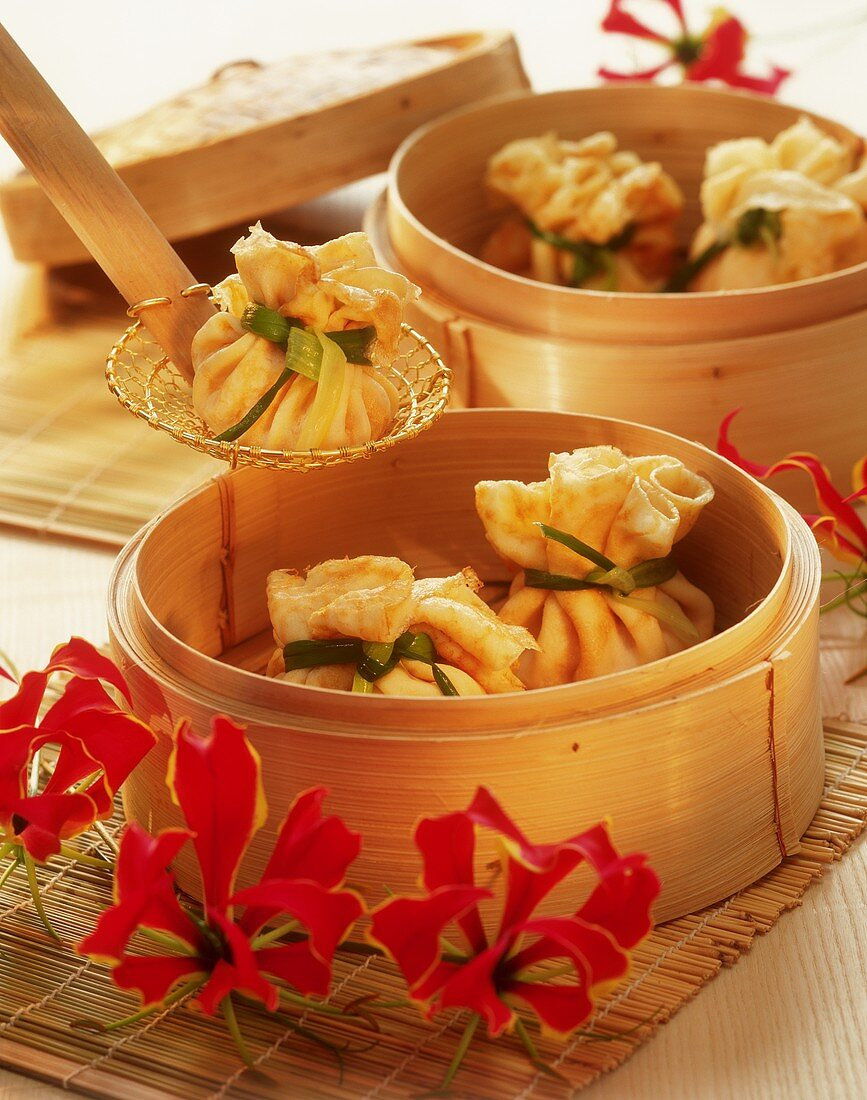 Shrimp parcels in bamboo steamer and on slotted spoon
