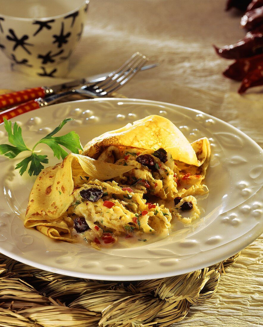 Galettes with spicy cabbage and sour cherries on plate