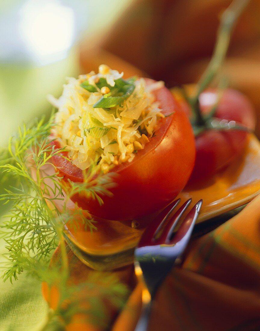 Stuffed tomato with buckwheat, sauerkraut, spring onions