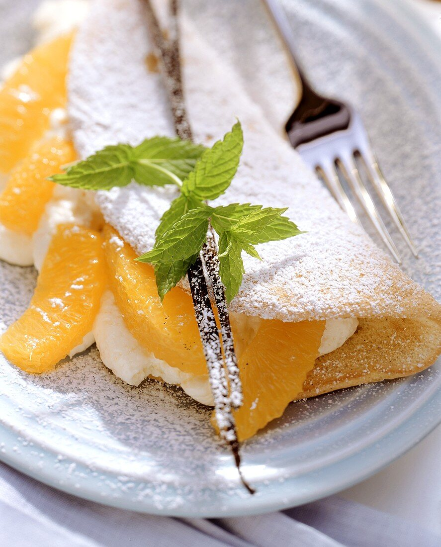 Sponge omelette with orange mousse, orange segments & mint