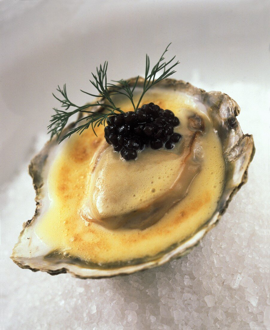 Oysters a la crème with dabs of caviare and dill