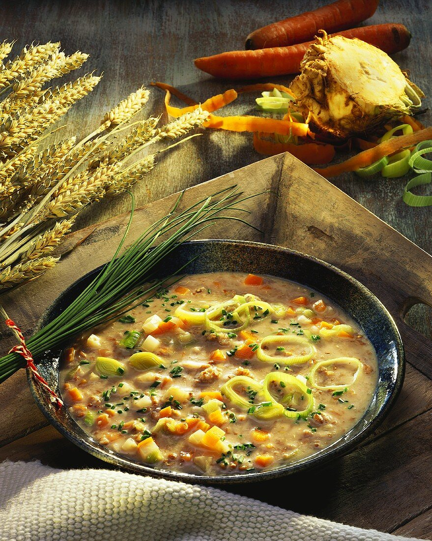 Creamed green rye soup with vegetables and chives