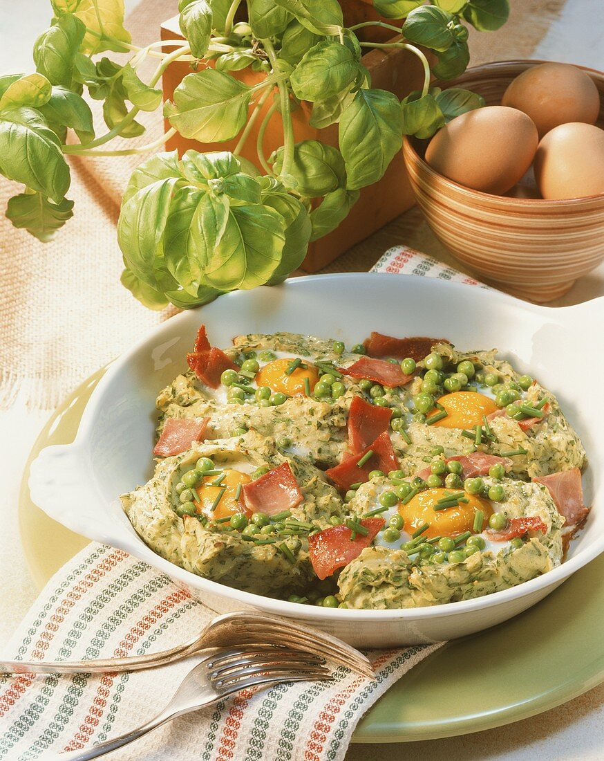 Baked herby potato nests with egg, peas and ham