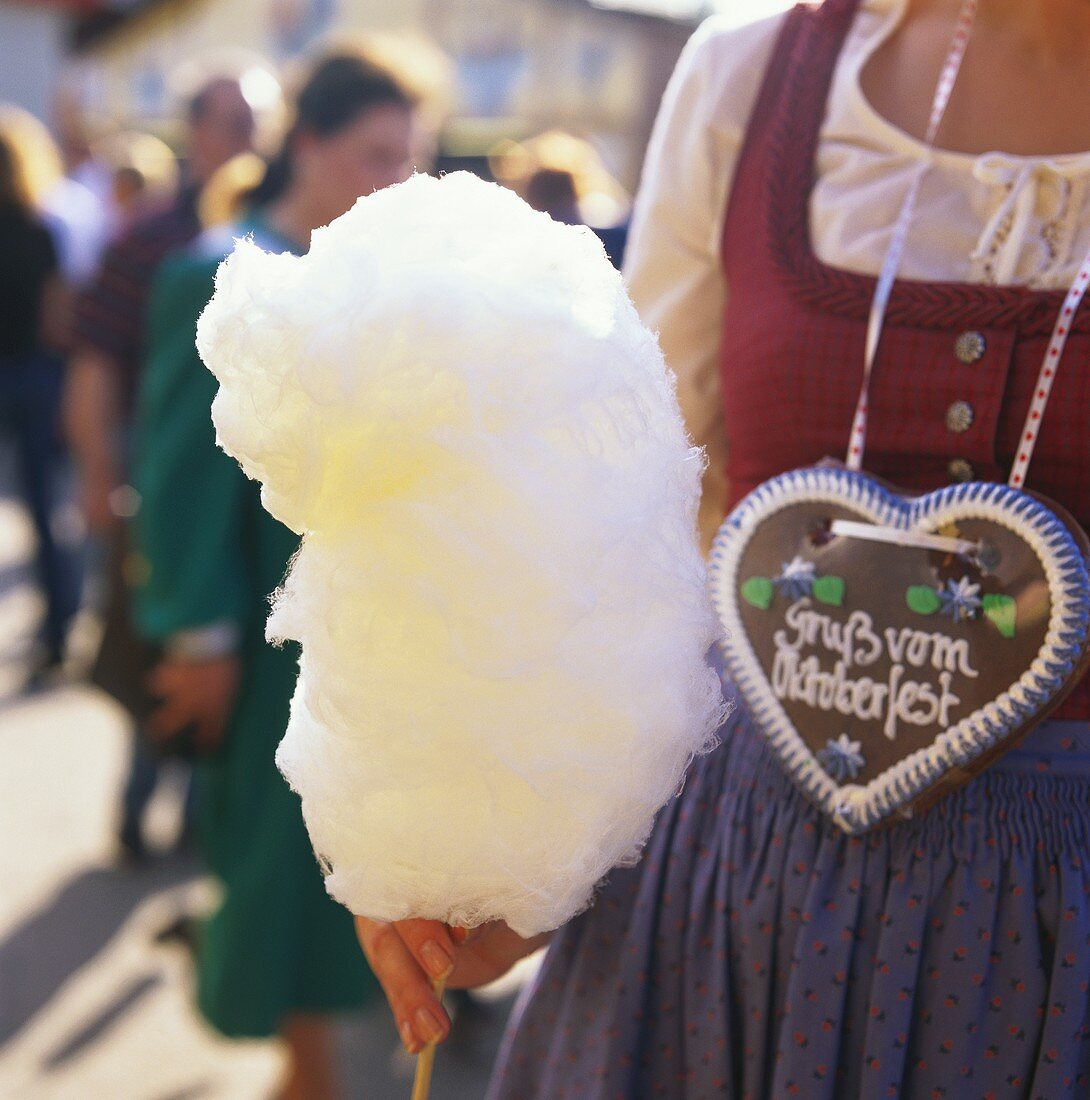 Woman with candy floss and gingerbread heart