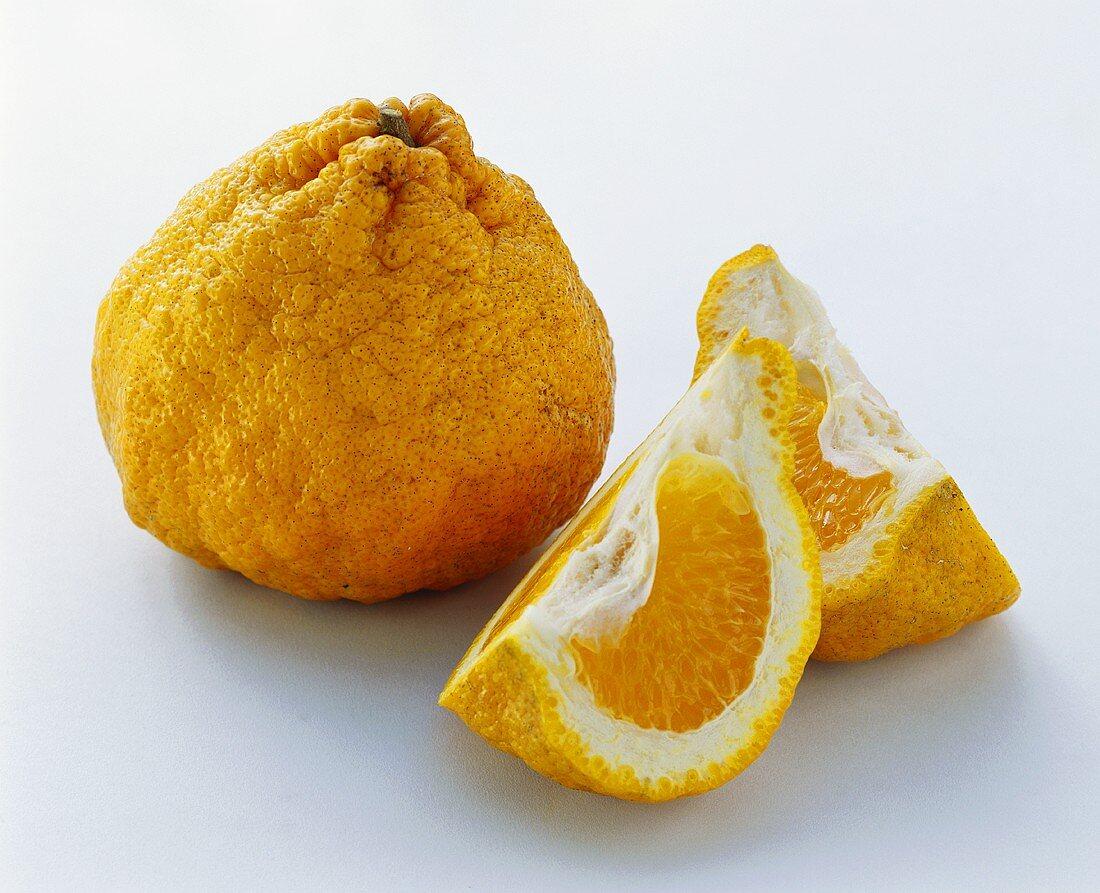 Whole ugli fruit and two segments