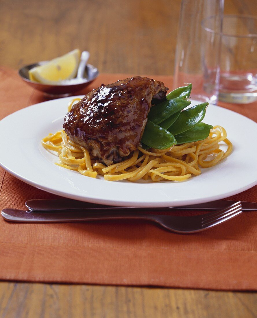 Chicken with mangetouts on noodles