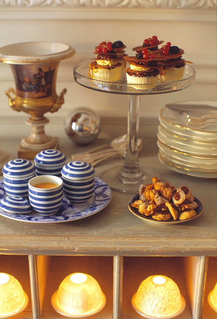 Buffet with small cakes, biscuits and coffee