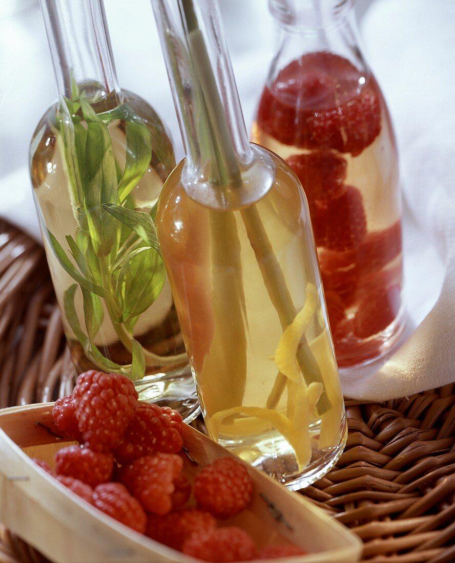 Lemon, tarragon and raspberry vinegar in bottles