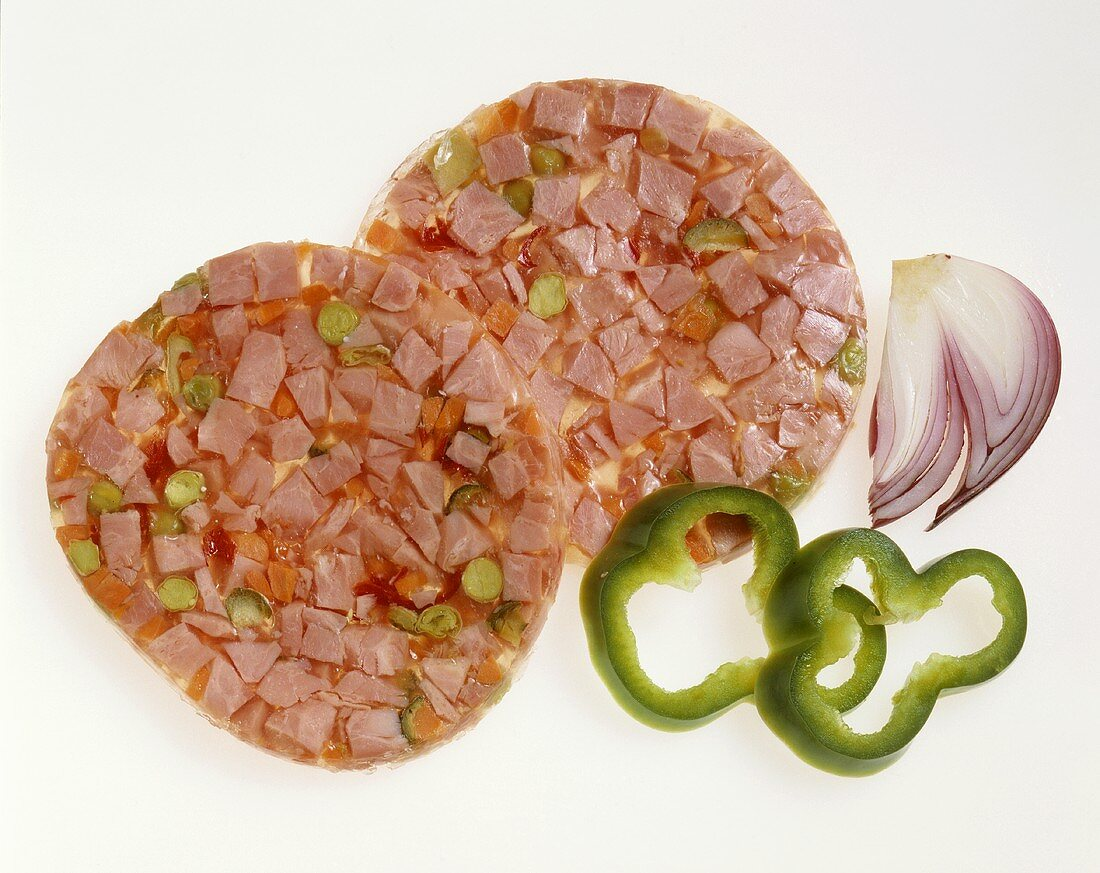 Two slices of jellied ham, pepper slices and onion