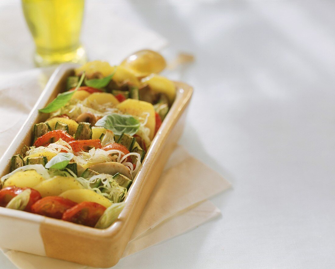 Vegetable and potato gratin with olive oil in baking dish