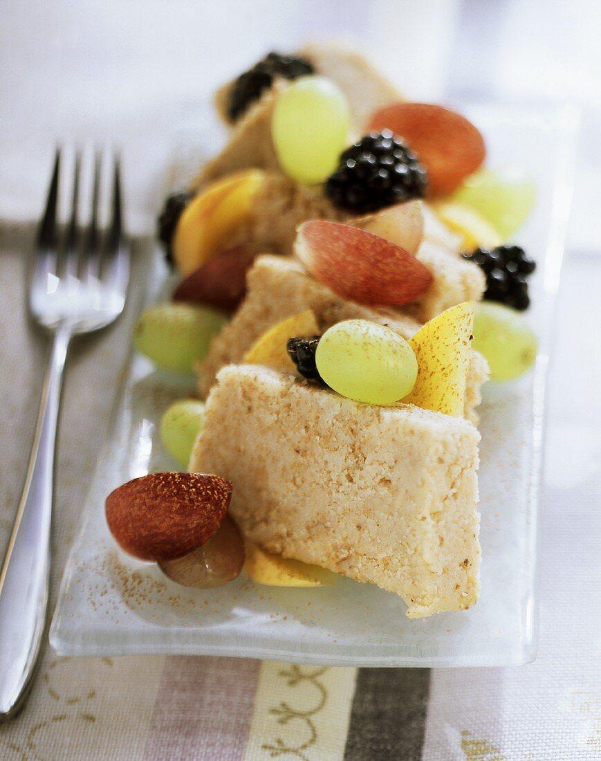 Semolina halva with fresh berries, grapes and pears