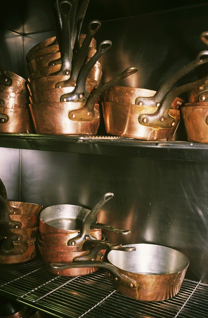 Copper pans in French restaurant kitchen