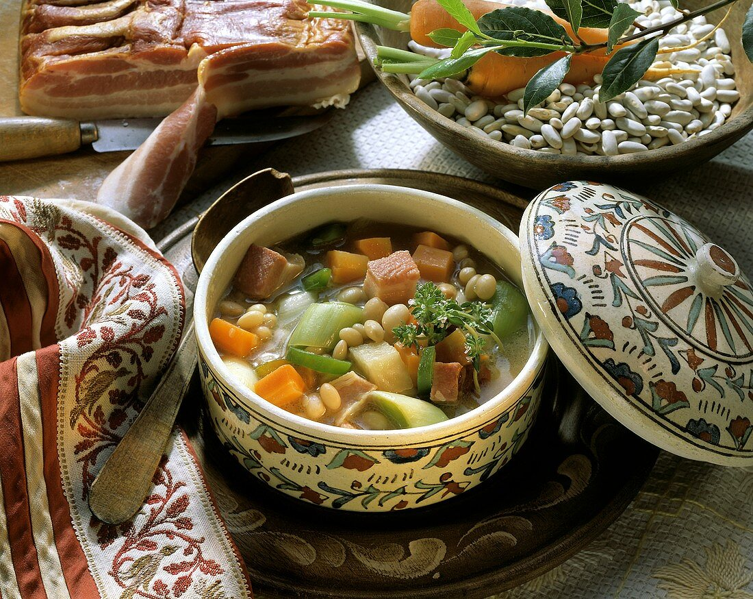 Serbian bean soup with bacon, leeks and carrots