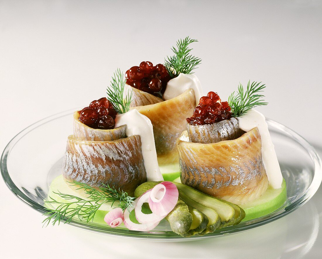 Matje herring rolls with cream sauce and cranberry compote