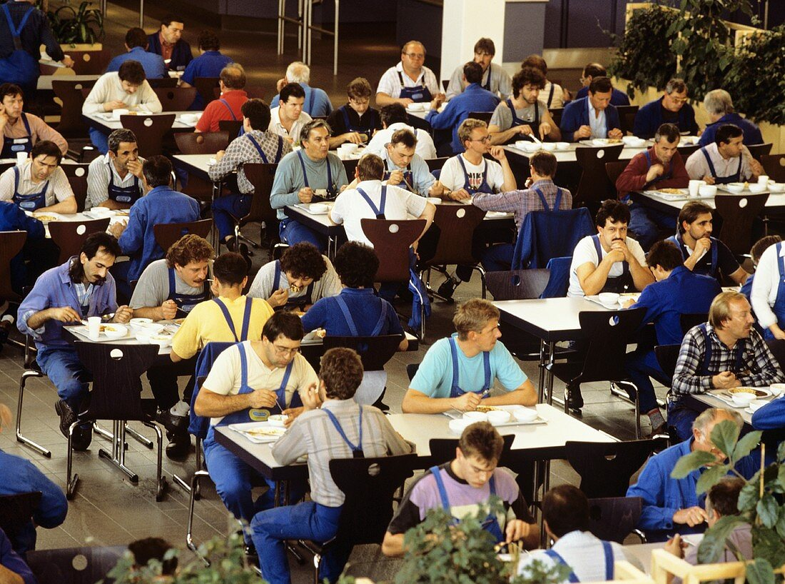 People in the canteen of an industrial company