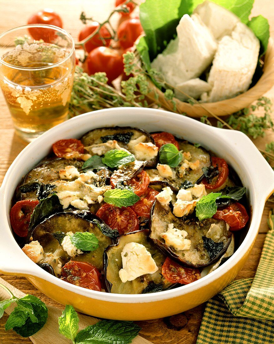 Aubergine and tomato casserole with cheese and fresh mint