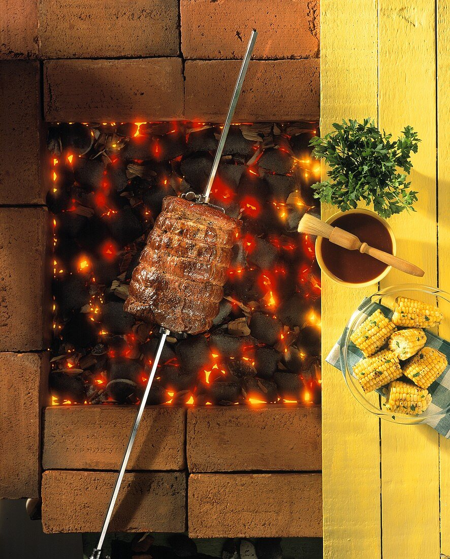 Beef on skewer over glowing charcoal