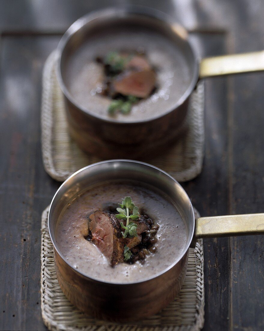 Lentil soup with fried rabbit liver in copper pans
