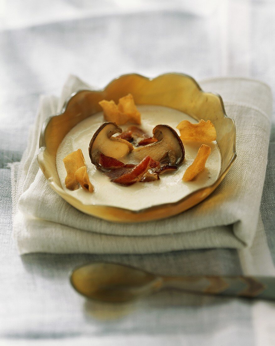 Jerusalem artichoke soup with ceps, bacon & vegetable crisps