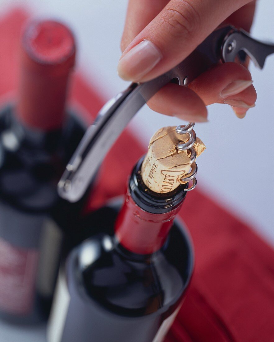 Opening red wine bottle (corkscrew positioned badly)