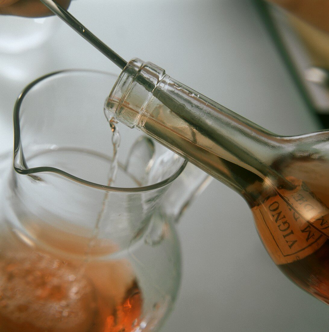 Decanting wine with cork remains into carafe