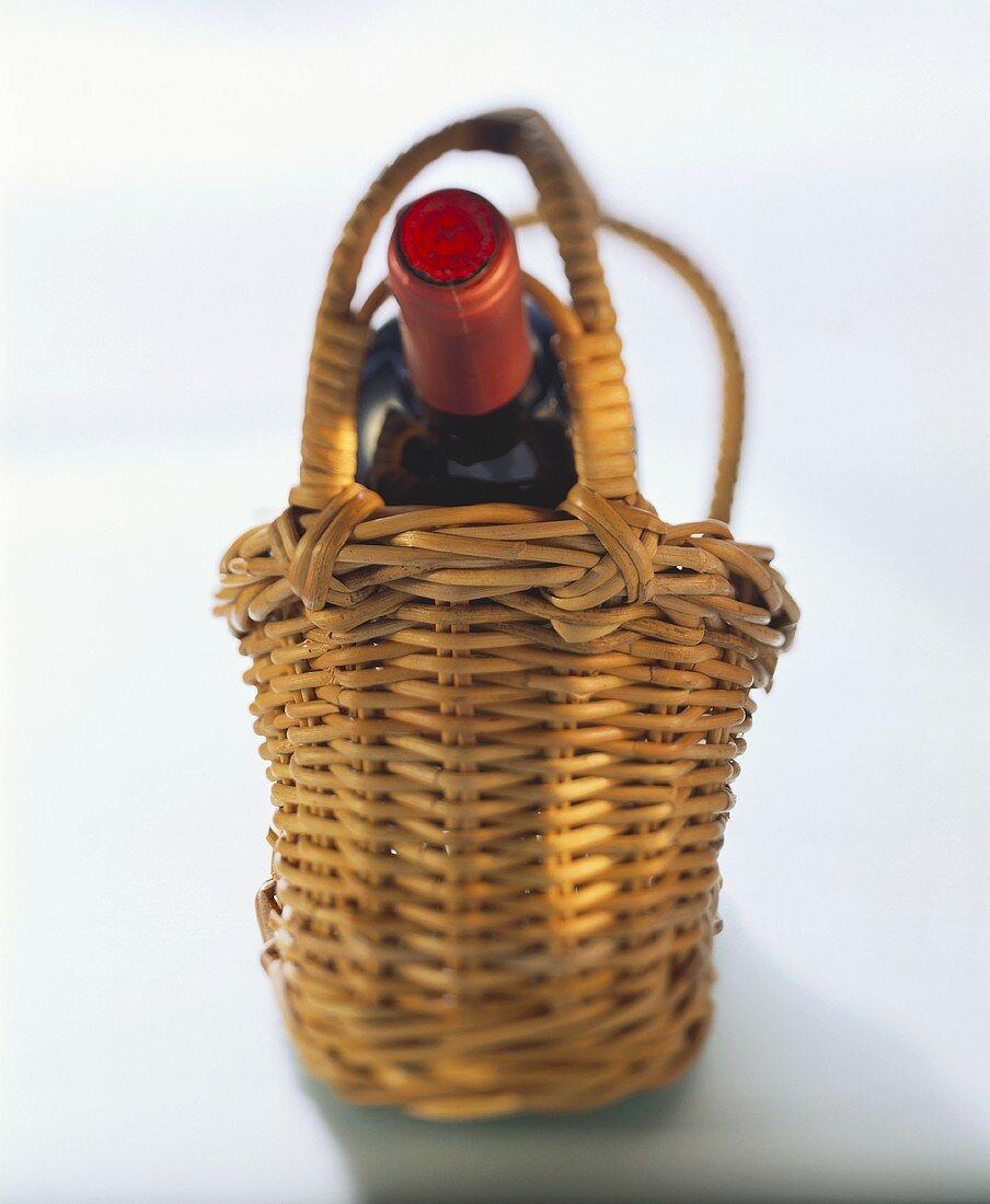 Red wine bottle in wine basket