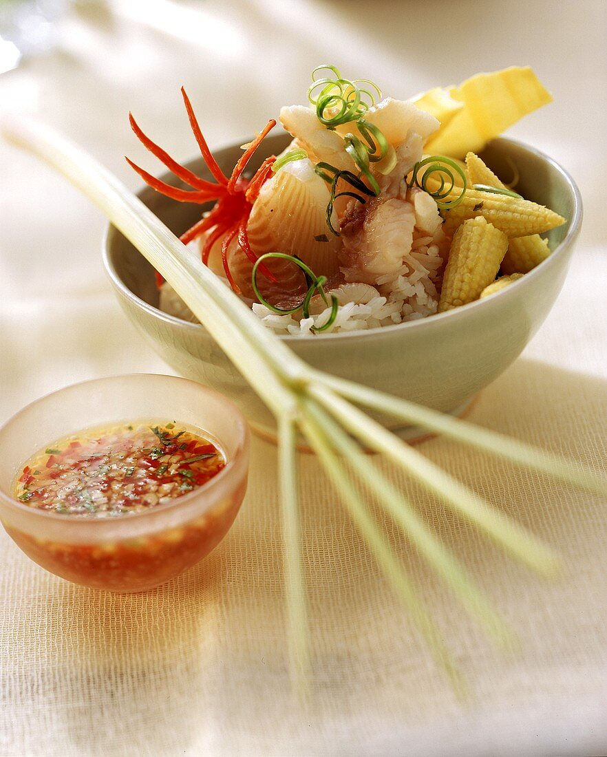 Fish fondue, Thai style, with rice and chili sauce