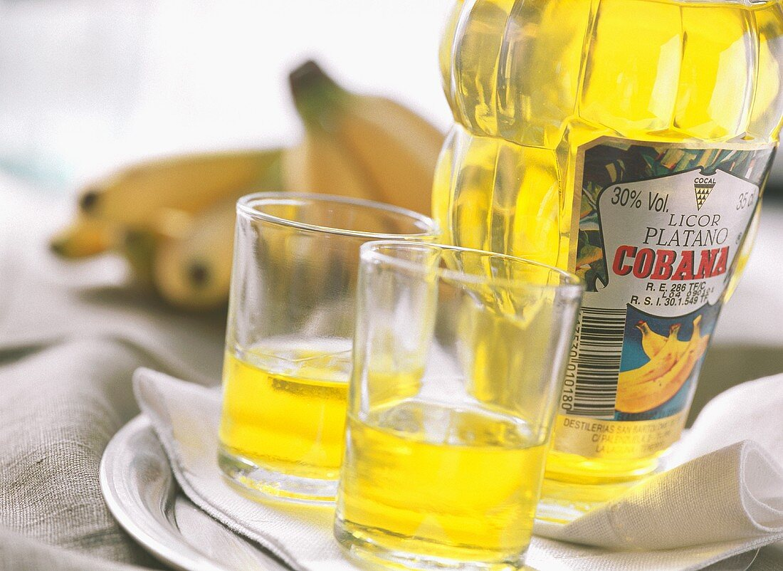 Canarian banana liqueur in bottle and glasses