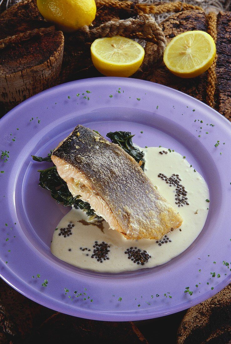 Norwegian salmon on spinach with white wine sauce