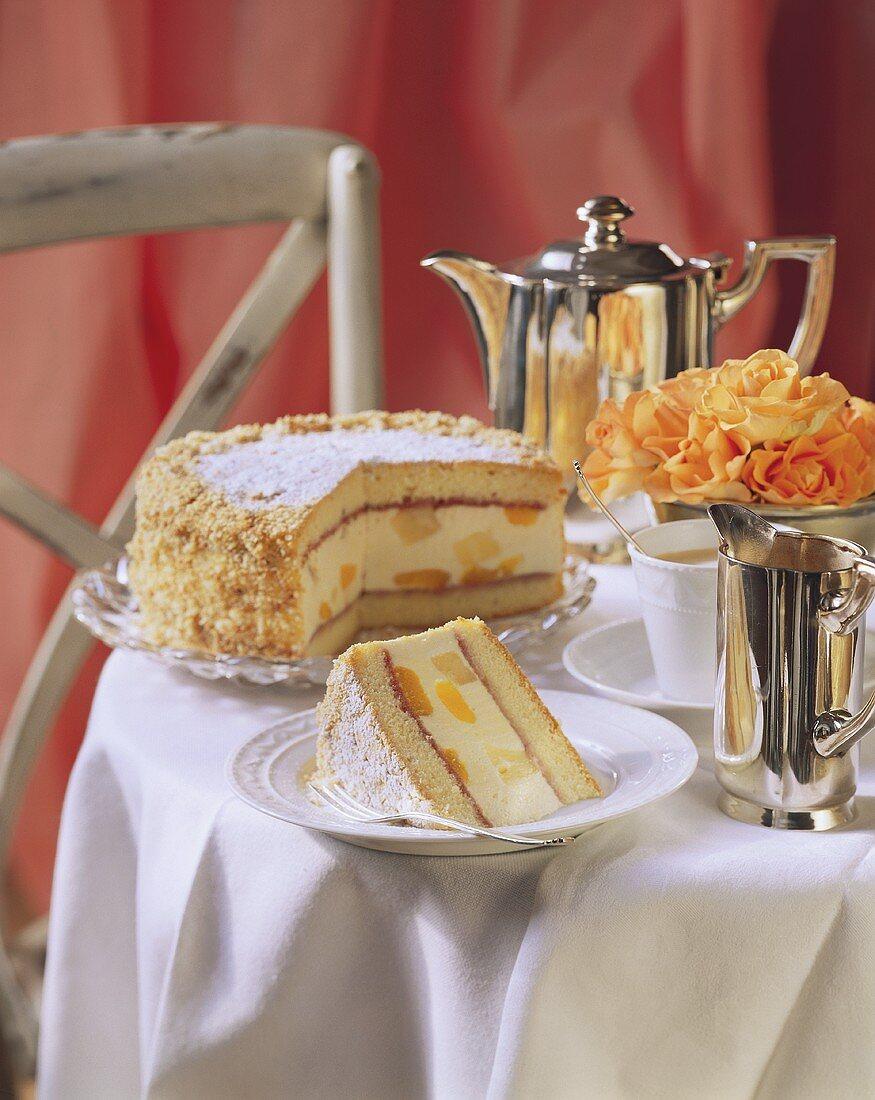 Sponge quark cake with fruit on coffee table