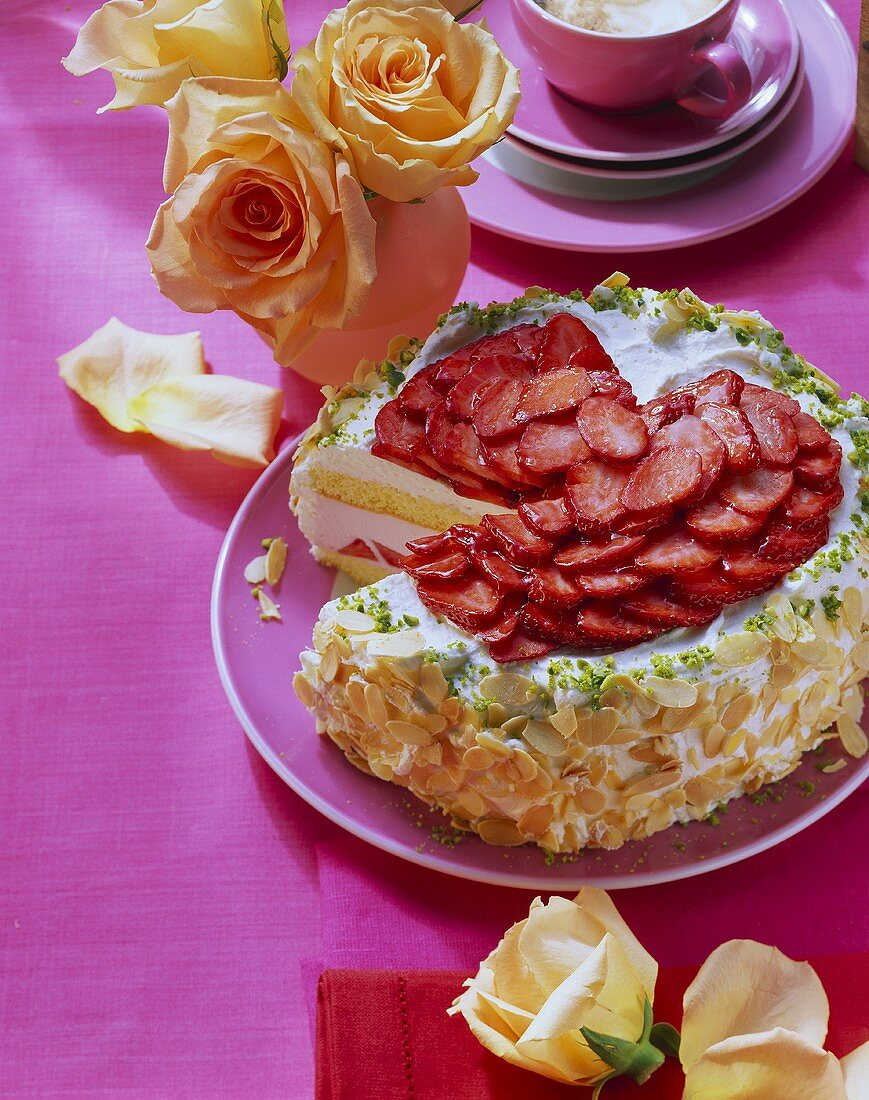 Panna cotta cake with strawberries & almond border; roses
