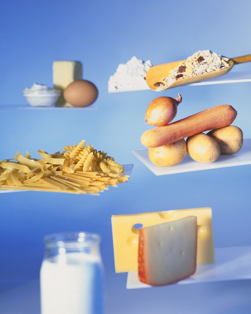 Various organic products: pasta, vegetables, muesli, cheese