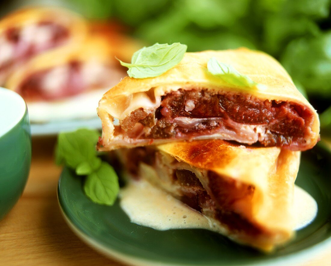 Plum strudel with mint leaves