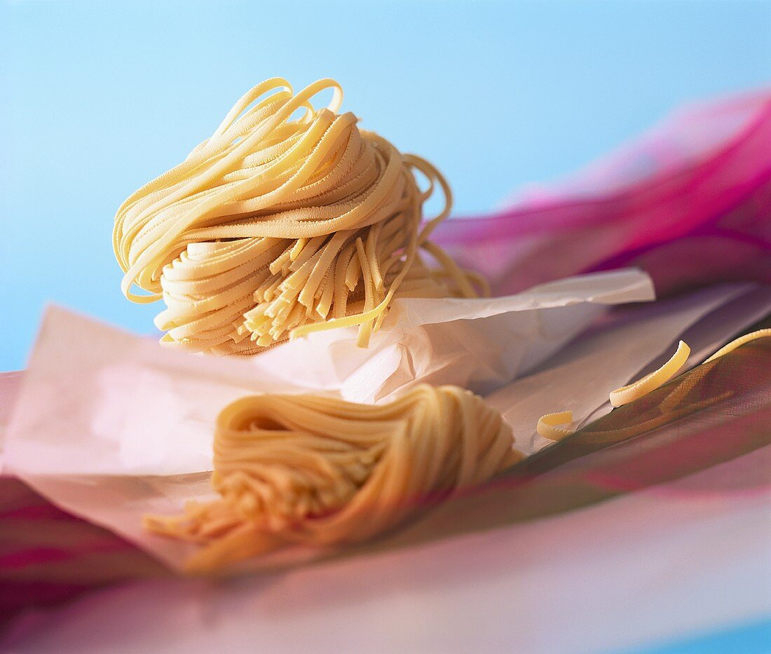 Home-made ribbon noodles on paper