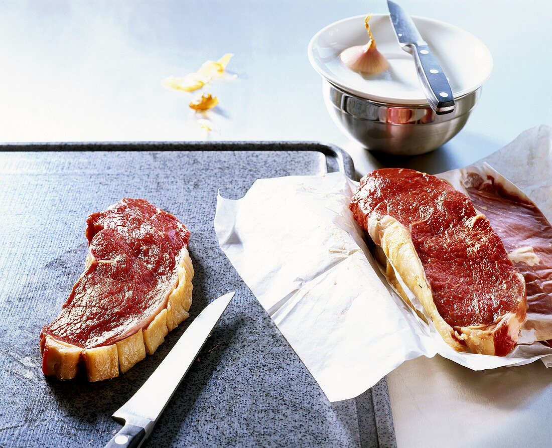 Snipping the fatty edge on beef steak