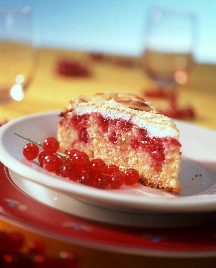 Piece of redcurrant and almond meringue cake