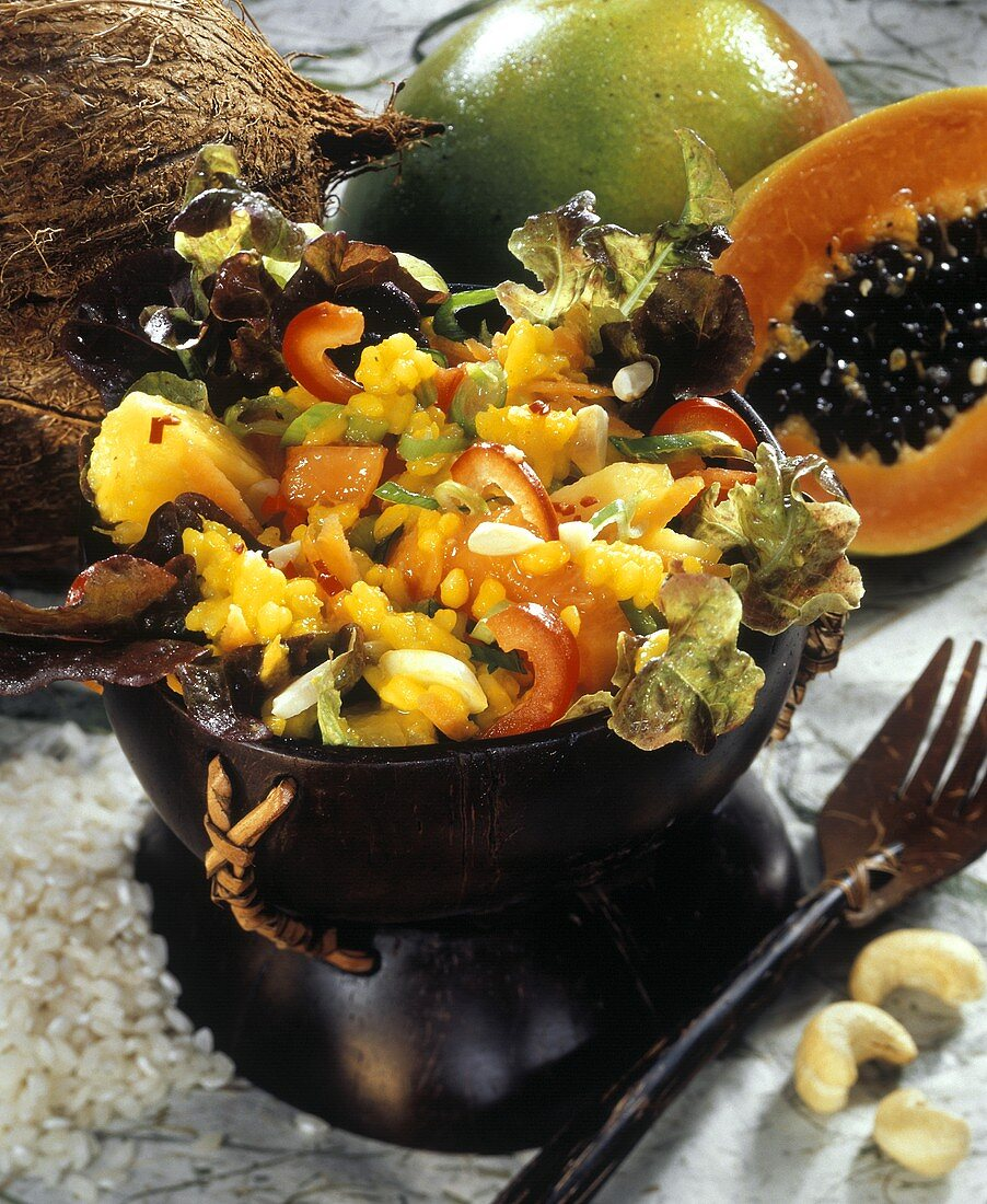 Exotic rice salad with coconut, vegetables and fruit