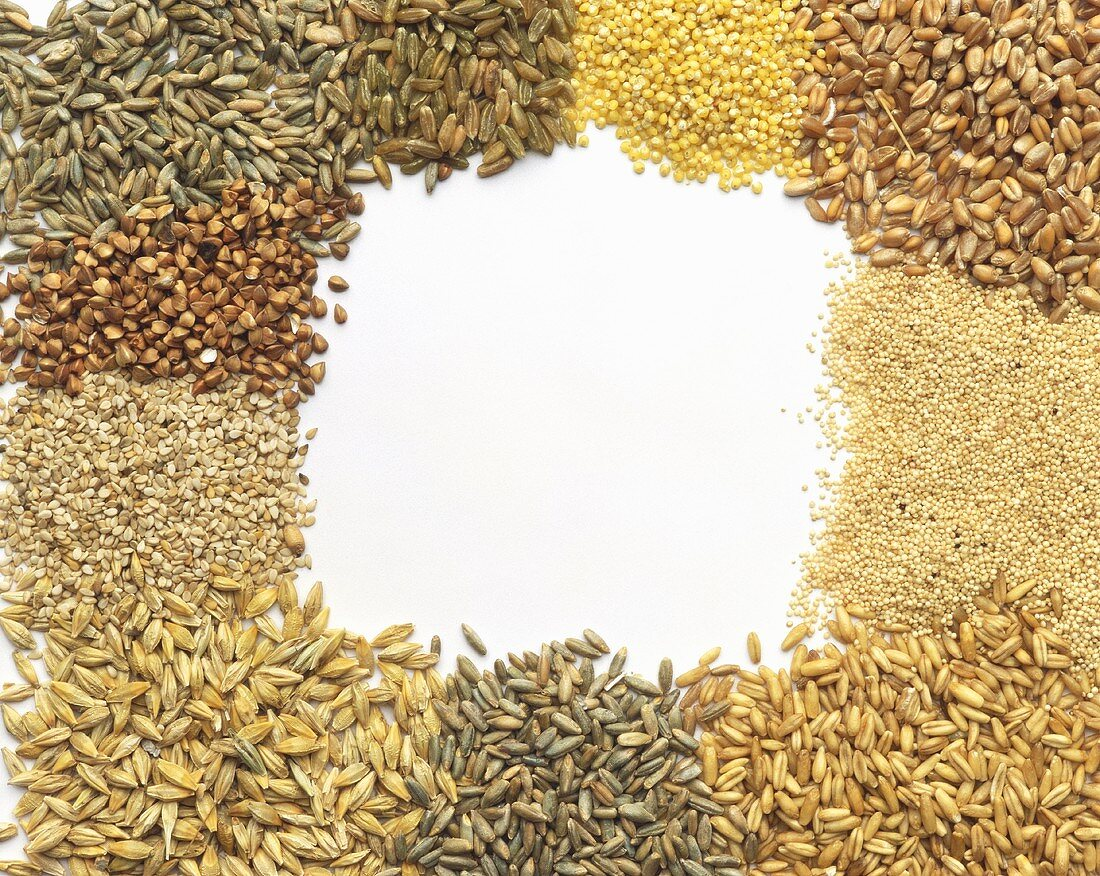 Various types of cereals arranged around edge of picture