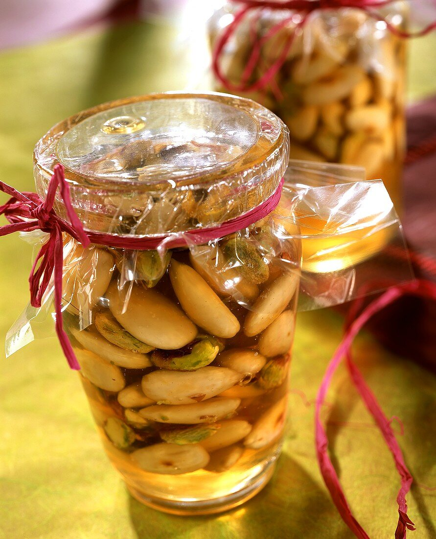 Honeyed almonds with pistachios in preserving jar